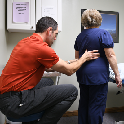 Therapist helping patient with balance therapy