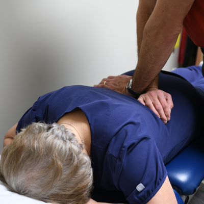 Occupational therapist working on patient's back