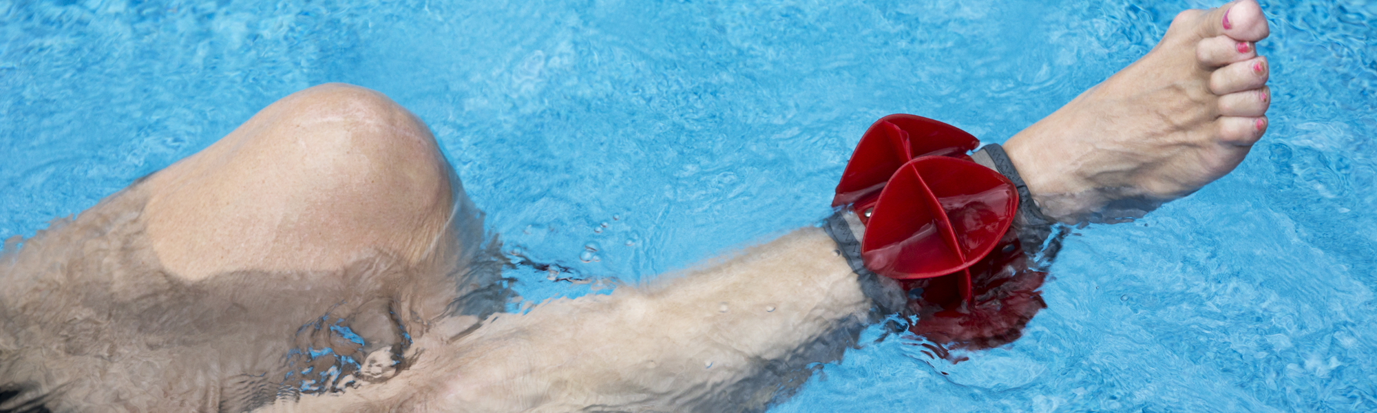 Person wearing a weight around ankle during aquatic therapy