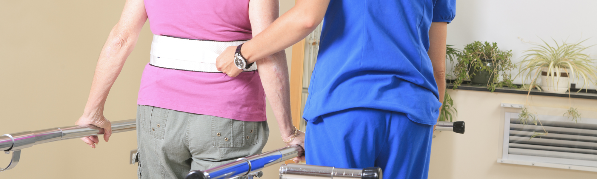 Physical therapist assisting patient with balance therapy